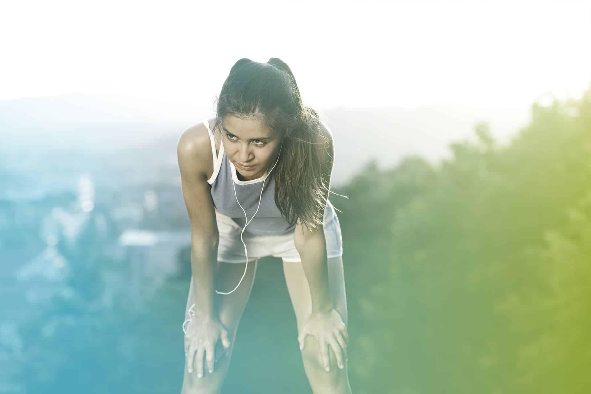 Frau Jogging Outdoor unzufrieden ausgepowert