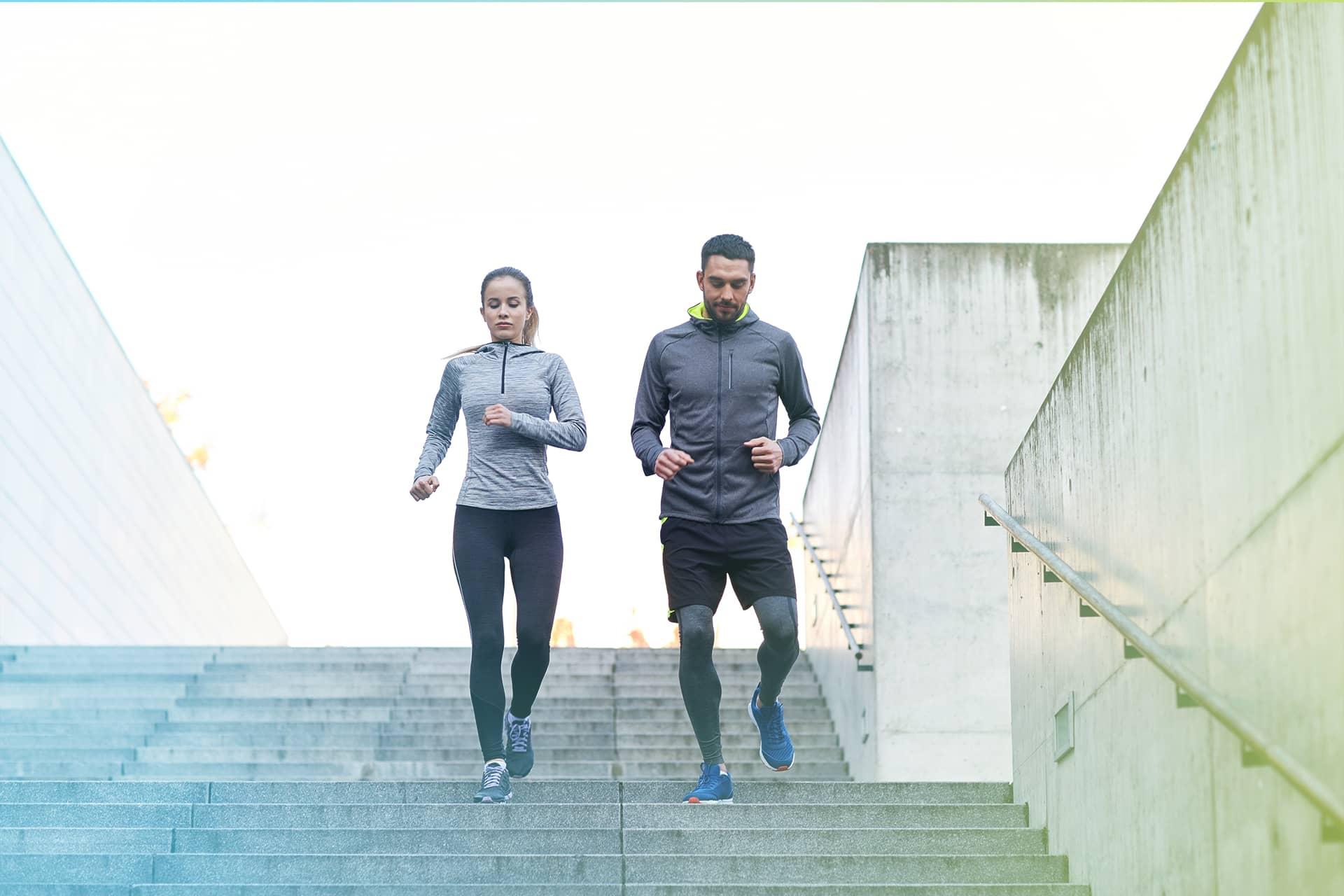 Outdoor Mann Frau Treppe Jogging Fitness
